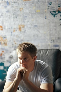 Pensive man sitting in front of map