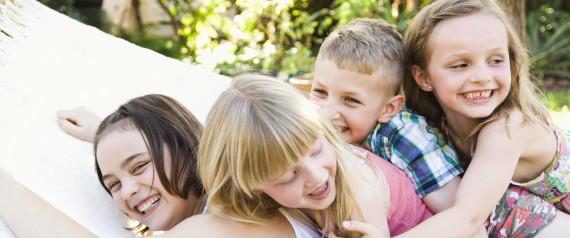 Caucasian children playing in tree
