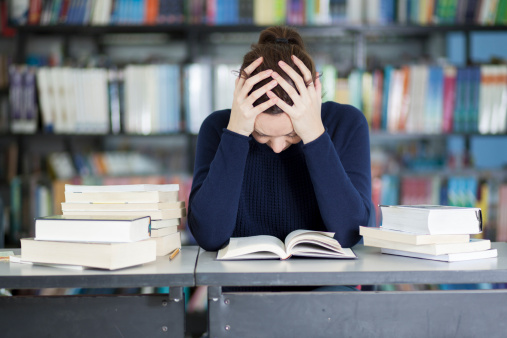 Female student overwhelmed with homework