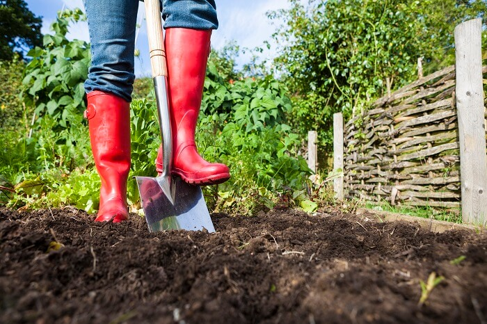 red-boots-digging-in-garden