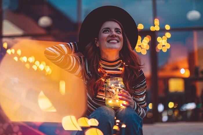 cheerful-woman-holding-lights